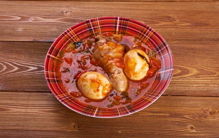 Doro Wat - Chicken marinated in Berbere sauce with boiled eggs. | Photo via Aplez